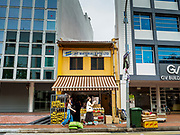 13 DECEMBER 2018 - SINGAPORE:  A traditional shophouse sandwhiched between two relatively new office buildings in the Geylang neighborhood. The Geylang area of Singapore, between the Central Business District and Changi Airport, was originally coconut plantations and Malay villages. During Singapore's boom the coconut plantations and other farms were pushed out and now the area is a working class community of Malay, Indian and Chinese people. In the 2000s, developers started gentrifying Geylang and new housing estate developments were built.    PHOTO BY JACK KURTZ