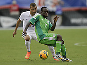 JACKSONVILLE, FL - JUNE 07:  Defender Fabian Johnson #23 of the United States challenges forward Victor Moses #11 of Nigeria during the international friendly match at EverBank Field on June 7, 2014 in Jacksonville, Florida.  (Photo by Mike Zarrilli/Getty Images)