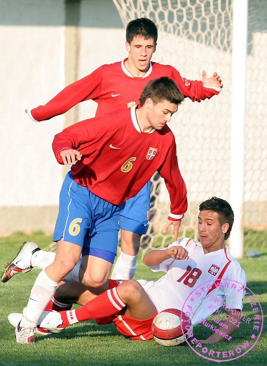 6.3.2007 Obrenovac-Serbia.Serbia-Poland friendly test match Under 16 years.Milicic Velibor(L) Serbia and Podrygala Patrick(R) Poland.Foto:Aleksandar Djorovic
