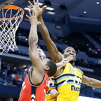 18 November 2016: Toronto Raptors guard Kyle Lowry (7) goes for the layup against Denver Nuggets forward Kenneth Faried (35) and Denver Nuggets center Jusuf Nurkic (23) during the Toronto Raptors 113-111 OT victory over the Denver Nuggets, at the Pepsi Center, Denver, Colorado, USA.