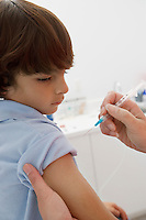 Boy receiving injection,close-up