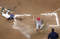 Panamanian third base, Luis Iglesias, center, scored a run in the seventh. Inning during a game between Panama and Nicaragua at the Victoria de Giron stadium during the XXXV World Cup Baseball tournament on Wednesday October 22, 2003, Matanzas, Cuba. Panama won 5 by 0. (AP Photo/Cristobal Herrera)