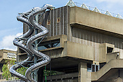"Carsten Höller's helter-skelter (Isomeric) slides come back to London - at South Bank's Hayward Gallery.  The modern artist is probably most famous in London for his installation at the Tate Modern, in which children and grown ups alike could slide down a 56-metre long helter-skelter back in 2007 – this time they run from the gallery's glass pyramid ceiling to the entrance several floors below. They are part of Decision, the interactive exhibition which will run from June 10 to September 6 and will include - two robotic beds that will mirror each other's movements as they roam the gallery; and an installation called Flying Machines, which will be installed in the gallery's outdoor terrace opposite Waterloo Bridge, giving visitors ""the sensation of soaring above city traffic""."
