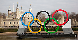 © Licensed to London News Pictures. 28/02/2012. London, England. View with the Tower of London. Giant Olympic rings measuring 11 metres high by 25 metres wide are floated down the River Thames on a barge, marking 150 days to go to the start of the London 2012 Olympic and Paralympic Games. Photo credit: Bettina Strenske/LNP