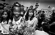 Jessica Wordlaw walks out of the gym with roses given her by family members following the Sixth Grade Recognition Program. She received the school's final citizenship award.