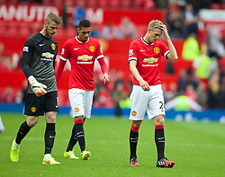 16.08.2014, Old Trafford, Manchester, ENG, Premier League, Manchester United vs Swansea City, 1. Runde, im Bild Manchester United's goalkeeper David de Gea and Darren Fletcher look dejected after their side's opening day defeat to Swansea City // 15054000 during the English Premier League 1st round match between Manchester United and Swansea City AFC at Old Trafford in Manchester, Great Britain on 2014/08/16. EXPA Pictures © 2014, PhotoCredit: EXPA/ Propagandaphoto/ David Rawcliffe<br /> <br /> *****ATTENTION - OUT of ENG, GBR*****