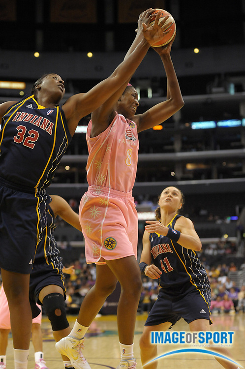 Aug 9, 2010; Los Angeles, CA, USA; Los Angeles Sparks forward DeLisha Milton-Jones (8), center, battles for the rebound with Indiana Fever forward Ebony Hoffman (32), left, and guard Tully Bevilaqua (41) at the Staples Center. The Fever defeated the Sparks 82-76. Photo by Image of Sport