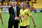 Head Coach of the Phoenix Ernie Merrick (L) shakes Manny Muscat's hand after his last game for the Phoenix during the A-League - Wellington Phoenix v Western Sydney football match at Westpac Stadium in Wellington on Sunday the 10 April 2016. Copyright Photo by Marty Melville / www.Photosport.nz