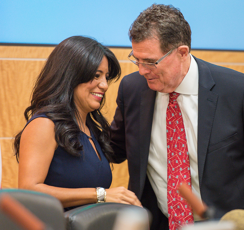 Diana Dávila talks with Houston ISD Superintendent Dr. Terry Grier after being sworn in during ceremonies for newly elected trustees, January 14, 2016.
