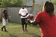 Terrence Talbott (left) and Terry Talbott, Jr.  pass a football with thier mother Natasha White,  Sunday August 12, 2007.