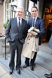 Left to right, PAUL O'GRADY and ANDRE PORTASIO at a reception for the Castle of Mey held at the Goring Hotel, London on 19th May 2009.
