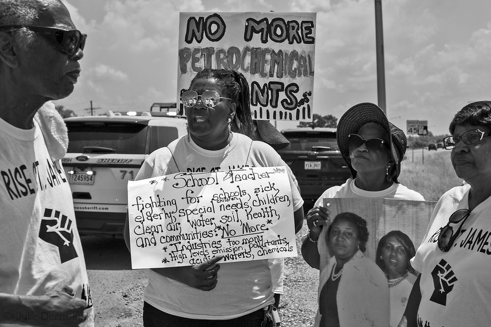 "Stephanie Cooper, the Vice President of Rise St. James  holding a sign Welcome Louisaina on the third day of a five day march through Louisiana's 'Cancer Alley' held by the Coalition Against Death Alley. The Coalition Against Death Alley (CADA), is a group of Louisiana-based residents and members of various local and state organizations, is calling for a stop to the construction of new petrochemical plants and the passing of stricter regulations on existing industry in the area that include the groups RISE St. James, Justice and Beyond, the Louisiana Bucket Brigade, 350 New Orleans, and the Concerned Citizens of St. John  Louisiana's Cancer Alley, an 80-mile stretch along the Mississippi River, is also known as the ""Petrochemical Corridor,"" where there are over 100 petrochemical plants and refineries ."