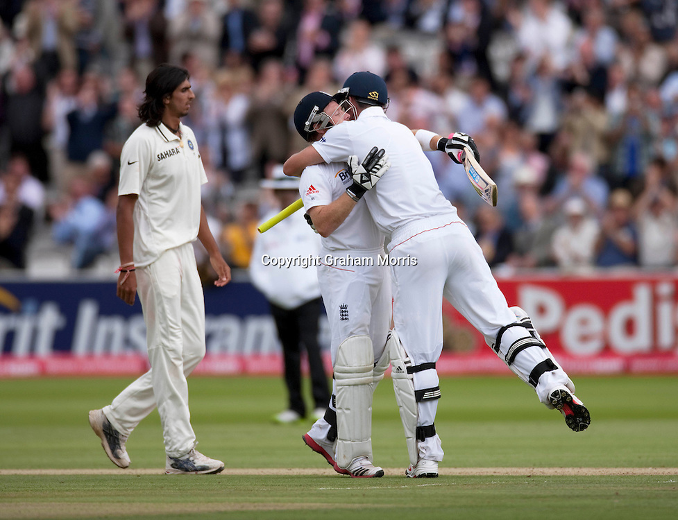 Kevin Pietersen celebrates his century (with Ian Bell) past bowler Ishant Sharma during the first npower Test Match between England and India at Lord's Cricket Ground, London.  Photo: Graham Morris (Tel: +44(0)20 8969 4192 Email: sales@cricketpix.com) 22/07/11