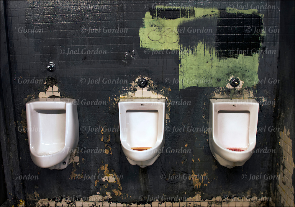 Dirty and unclean rundown urinals in restroom in  New York City park. Third word countries have cleaner restroom.<br /> <br /> A public toilet is a room or small building containing one or more toilets and possibly also urinals which is available for use by the general public, or in a broader meaning of &quot;public&quot;, by customers of other services. Public toilets are commonly separated by sex into male and female facilities,