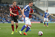 Chesterfield striker Kristian Dennis and Shrewsbury Town midfielder Bryn Morris  challenge for the ball during the EFL Sky Bet League 1 match between Chesterfield and Shrewsbury Town at the Proact Stadium, Chesterfield, England on 11 March 2017. Photo by Aaron  Lupton.