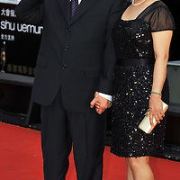 HONG KONG - APRIL 19:  Hong Kong director John Woo (L) and his wife Ann Woo arrive to the 28th Hong Kong Film Awards 2009 at the Hong Kong's Cultural Centre on April 19, 2009.  Photo by Victor Fraile / studioEAST