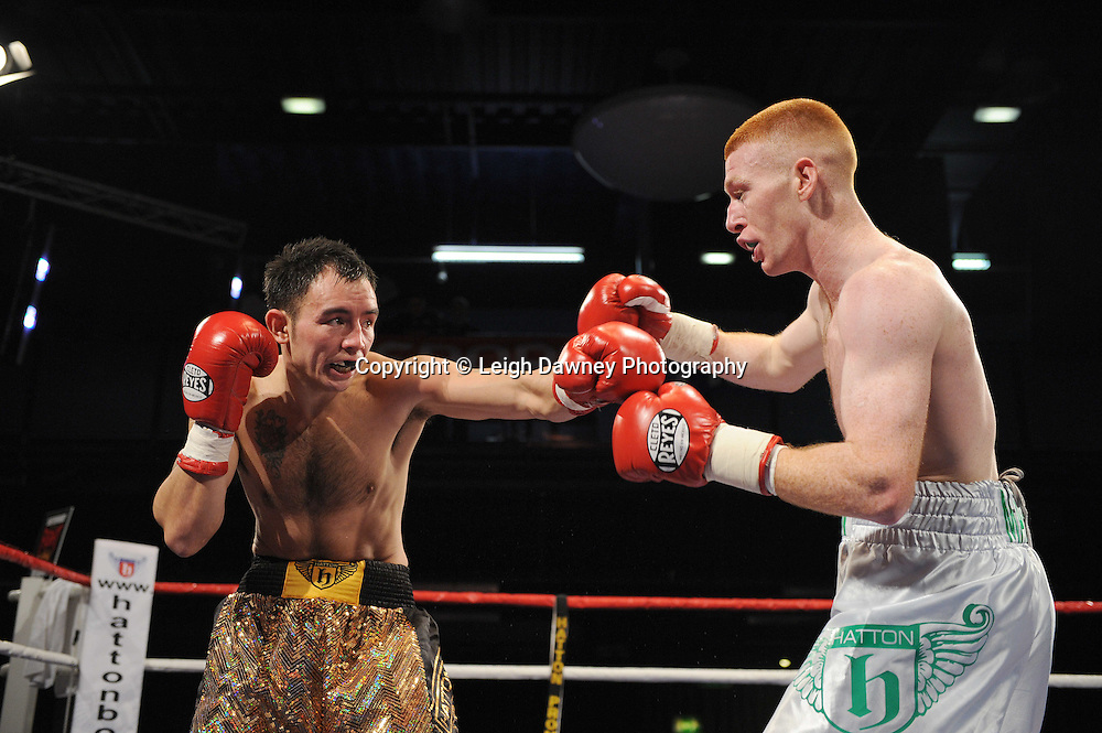 Kieran Maher (white shorts) v Lester Walsh at the Reebok Stadium on Saturday 26th February 2011. Hatton Promotions. Photo credit © Leigh Dawney.