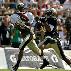 July 31, 2010; Metairie, LA, USA; New Orleans Saints wide receiver Montez Billings (89) loses his grip on the ball after beating rookie cornerback Patrick Robinson (34) on a deep route during a training camp practice at the New Orleans Saints practice facility. Mandatory Credit: Derick E. Hingle