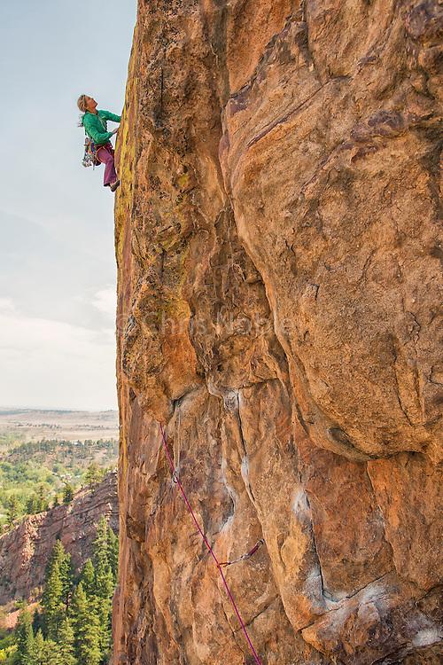 "Legendary climber Lynn Hill climbing""Outer Space"" 10b, Northwest Buttress of the Bastille, Eldorado Canyon, Colorado."
