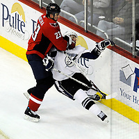 26 December 2007:  Washington Capitals defenseman Milan Jurcina (23) takes down Tampa Bay Lightning right wing Martin St. Louis (26) in the third period at the Verizon Center in Washington, D.C.  The Capitals defeated the Lightning 3-2.