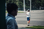 Exclusive<br /> The North Korea that Kim doesn&rsquo;t want you to see: Sweeping dirt under the watch of soldiers, fearful waitresses and unlit streets among fascinating illegal images of rogue state <br /> <br /> A daring photographer has risked detention to smuggle a series of stunning images of North Korea out of the secretive state.<br /> Michal Huniewicz captured the photographs he knew Kim Jong-un would not want you to see during a trip to the country, before sneaking them out on hidden memory cards.<br /> Unlike the polished photographs peddled by the state-run news agency, Mr Huniewicz&rsquo;s images give a raw insight into a poverty-ridden country controlled by a dictator. <br /> He went to North Korea from China last year and travelled with a tour guide - one of the conditions of being allowed a visit.<br /> Mr Huniewicz evaded his minder's watchful eye to take these photographs, which give a unique glimpse into North Koreans' everyday lives.<br /> Some are pictured working in the fields, while others are seen working in the squeaky-clean capital, Pyongyang.<br /> In one image, street cleaners sweep pavements under the watchful eye of a soldier in one of Pyongyang's parks, and others reveal waitresses working in restaurants where propaganda images are broadcast around the clock on television.<br /> A photograph of a customs form reveals what cannot be brought into the country. Mr Huniewicz revealed laptops are searched for the Hollywood film The Interview, a comedy about Kim Jong-un, which is banned in North Korea<br /> &copy;Michal Huniewicz /Exclusivepix Media