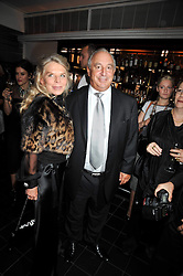 SIR PHILIP & LADY GREEN at a dinner hosted by Alexandra Shulman editor of British Vogue in association with Net-A-Porter.com to celebrate 25 years of London Fashion Week and Nick Knight held at Le Caprice, Arlington Street, London on 21st September 2009.