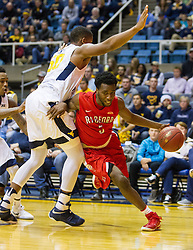 Dec 20, 2016; Morgantown, WV, USA; Radford Highlanders guard Donald Hicks (5) drives past West Virginia Mountaineers forward Sagaba Konate (50) during the first half at WVU Coliseum. Mandatory Credit: Ben Queen-USA TODAY Sports