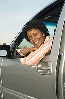 Woman Sitting in Driver's Seat