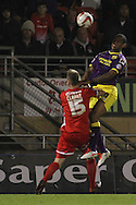 Picture by David Horn/Focus Images Ltd +44 7545 970036<br /> 17/09/2013<br /> Danny Haynes of Notts County scores to make it 3-1 beating Nathan Clarke in the air during the Sky Bet League 1 match at the Matchroom Stadium, London.