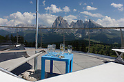 Cable car drinks terrace panaorama above the Siusi plateau, above the South Tyrolean town of Ortisei-Sankt Ulrich in the Dolomites, Italy.