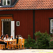 "Gamla Uppsala, ""Old Uppsala"", dating back to the 3rd century A.D. was known throughout Northern Europe as the residence of the Swedish kings of the legendary House of Yngling Dynasty. Locals celebrate their history on special holidays.<br /> Photography by Jose More"