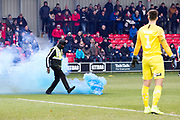 Away fans (not in the photo) throw flares onto the pitch during the EFL Sky Bet League 2 match between Salford City and Macclesfield Town at the Peninsula Stadium, Salford, United Kingdom on 23 November 2019.