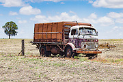 old commer farm truck in harvested field under cumuluas cloud near Emu Vale, Queensland, Australia