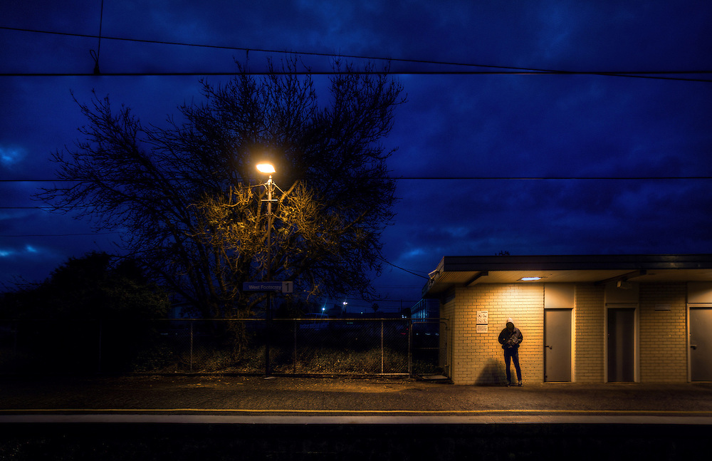 Railway Stations at night. West Footscray. About 6pm and a hooded young man is the only person on the station. Pic By Craig Sillitoe CSZ/The Sunday Age/The Age iPad App.15/6/2011 This photograph can be used for non commercial uses with attribution. Credit: Craig Sillitoe Photography / http://www.csillitoe.com<br />