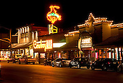 Bright lights on Cache Street at night in downtown Jackson Wyoming