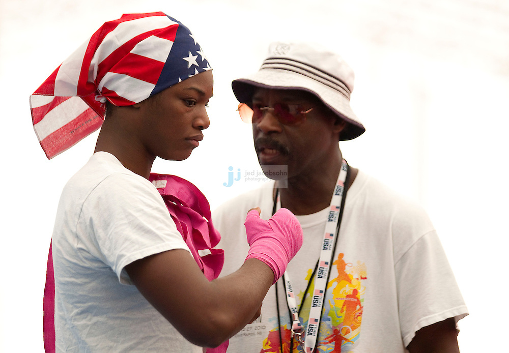 Claressa Shields of the USA Olympic boxing talks with a coach Al Mitchell, during a workout session at the SCORE Training Facility on July 26, 2012 in London, England. (Jed Jacobsohn/for The New York Times)....