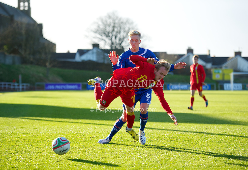 LLANELLI, WALES - Wednesday, February 6, 2013: Wales' Jonathan Williams in action against Iceland's Hordur Bjorgvin Magnusson during an International Friendly Under-21 match at Stebonheath Park. (Pic by David Rawcliffe/Propaganda)