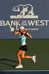 July 26, 2011; Stanford, CA, USA;  Anastasia Rodionova (AUS) returns the ball against Serena Williams (USA), not pictured, during the first round of the Bank of the West Classic women's tennis tournament at the Taube Family Tennis Stadium.