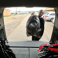Dr. Nickeda Shelton, a counselor at Vereona Elementary School, loads her vehicle as she picks up food from the Junior Auxiliary's Silent Servings program Friday morning in Tupelo. The Silent Servings bags are for area students lacking nutritional support at home and are packed every two weeks then picked up by a school employee and also delivered to the schools by a Junior Auxiliary member. The program allows the students to have snack over the weekend that they may otherwise not get.