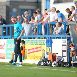 TELFORD COPYRIGHT MIKE SHERIDAN GOAL. Gavin Cowan watches on as the Nantwich Town bench celebrate their team's thrid goal during the National League North fixture between AFC Telford United and Nantwich Town on Saturday, September 21, 2019.<br /> <br /> Picture credit: Mike Sheridan<br /> <br /> MS201920-020