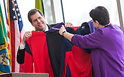 Gonzaga President Thayne McCulloh and University of Washington President Ana Mari Cauce compare their new sweatshirts which are half GU half UW after announcing a new partnership for medical education and research between the two schools. (Photo by Rajah Bose)