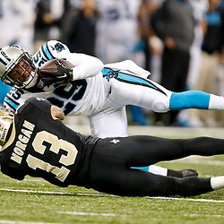Dec 7, 2014; New Orleans, LA, USA; \p29\ intercepts a pass over New Orleans Saints wide receiver Joseph Morgan (13) during the first quarter of a game at the Mercedes-Benz Superdome. Mandatory Credit: Derick E. Hingle-USA TODAY Sports