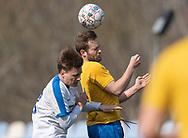 FODBOLD: Frederik Arentzen (Ølstykke FC) i duel med Mads Heegaard (Humlebæk) under kampen i Serie 2 mellem Ølstykke FC og Humlebæk Boldklub den 6. april 2019 på Ølstykke Stadion. Foto: Claus Birch.