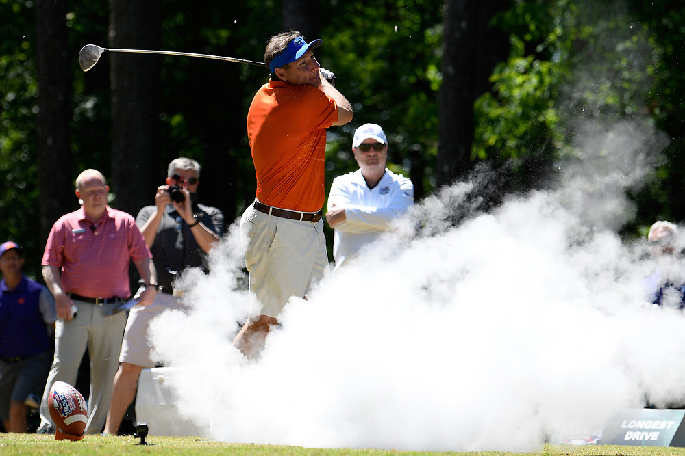 Dan Mullen gets pranked with an exploding golf ball during the Chick-fil-A Peach Bowl Challenge at the Oconee Golf Course at Reynolds Plantation, Sunday, May 1, 2018, in Greensboro, Georgia. (Dale Zanine via Abell Images for Chick-fil-A Peach Bowl Challenge)