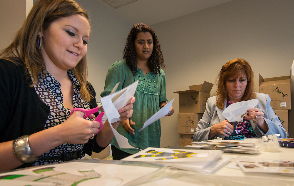 Volunteers prepare Focused Literacy Involvement Program (FLIP) boxes at the Children's Museum, October 21, 2014.