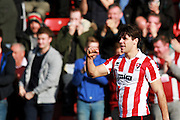 Dan Holman celebrates after scoring for The Robins during the Vanarama National League match between Cheltenham Town and Boreham Wood at Whaddon Road, Cheltenham, England on 25 March 2016. Photo by Carl Hewlett