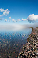 View along lakeshore with fog clearing to reveal long lakeshore, Yellowstone Lake, WY, © 2005 David A. Ponton