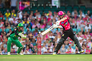 Sydney Sixers player Jordan Silk hits the ball at the Big Bash League cricket match between Sydney Sixers and Melbourne Stars at The Sydney Cricket Ground in Sydney, Australia