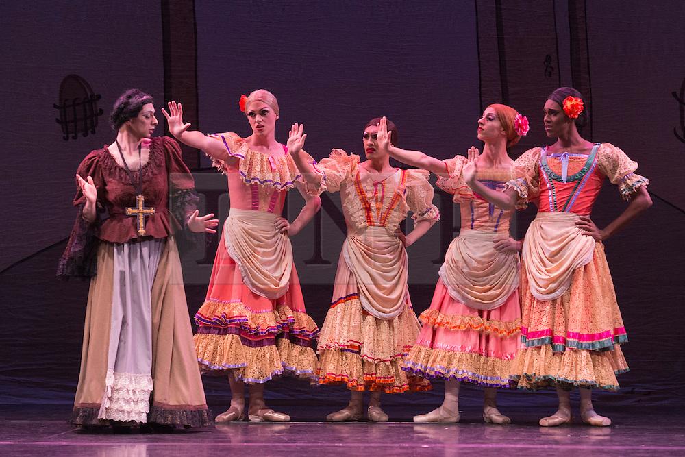 © Licensed to London News Pictures. 18/09/2015. London, UK. On the left: Lariska Dumbcheno (Raffaele Morra) as Mother. Les Ballets Trockadero de Monte Carlo (The Trocks) perform the UK premiere of Don Quixote during a photocall at the Peacock Theatre. With Yakaterina Verbosovich (Chase Johnsey) as Kitri, PVyacheslav Legupski (Paolo Cervellera) as Basil, Olga Supphozova (Robert Carter) as Amour, Lariska Dumbcheno (Raffaele Morra) as Mother, Boris Nowitsky (Carlos Renedo) as Count and Varvara Bractchikova (Giovanni Goffredo) and Eugenia Repelskii (Joshua Thake) as Gypsies. Photo credit: Bettina Strenske/LNP