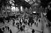 Commuters walk briskly to their train platfrom in Liverpool St station, London, U.K, 2000s.